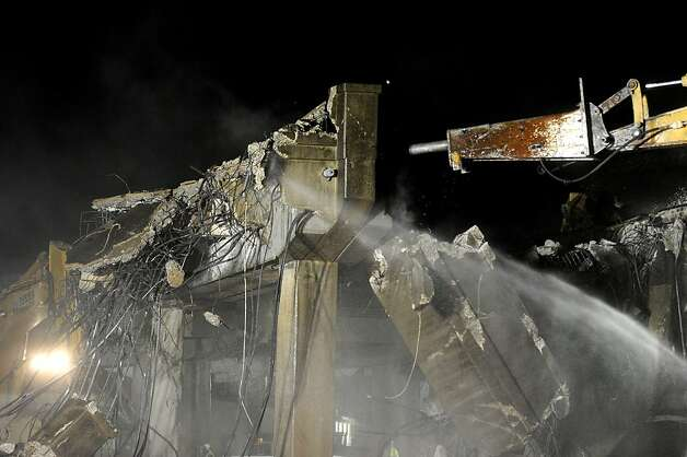 Support columns crumble as workers demolish a portion of Doyle Dr. on Friday, April 22, 2012, in San Francisco. Photo: Noah Berger, Special To The Chronicle