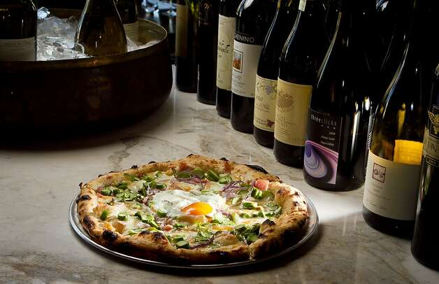 The Asparagus Pizza with Farm Egg in the wood fired oven at Redd Wood Restaurant in Yountville, Calif., is seen on April 6th, 2012. Photo: John Storey, Special To The Chronicle