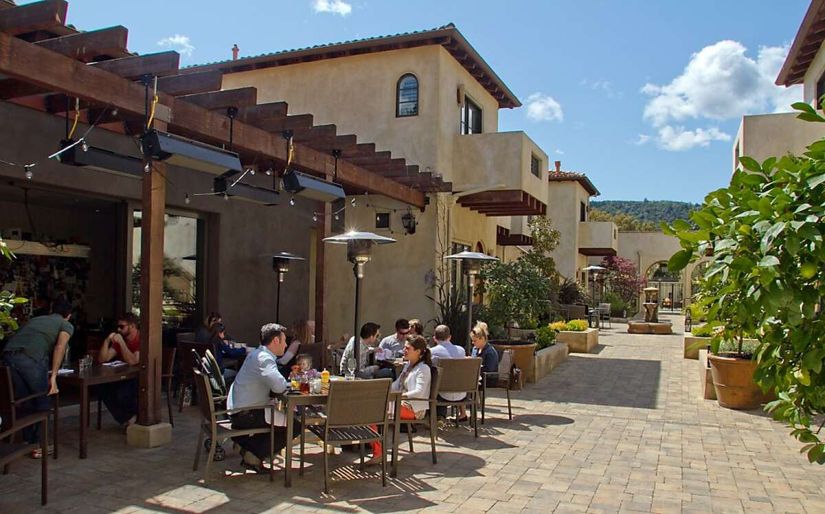 Diners enjoy lunch on the patio at Redd Wood in Yountville.