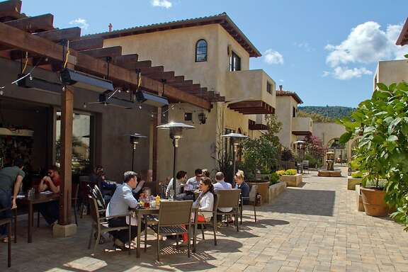 Diners enjoy lunch outside at Redd Wood Restaurant in Yountville, Calif., on April 6th, 2012.