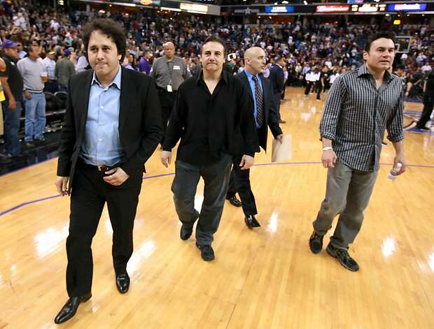 Brothers, George, left, Gavin second from left, and Phil Maloof, co owners of the Sacramento Kings leave the court after the Kings beat the Los Angeles Lakers 113-96 in a NBA basketball game in Sacramento, Calif., April 26, 2012.  The Maloofs met with Sacramento Mayor Kevin Johnson earlier in the day and are expected to have another meeting Friday to try to reach a deal for a new arena for the team. Photo: Rich Pedroncelli, Associated Press