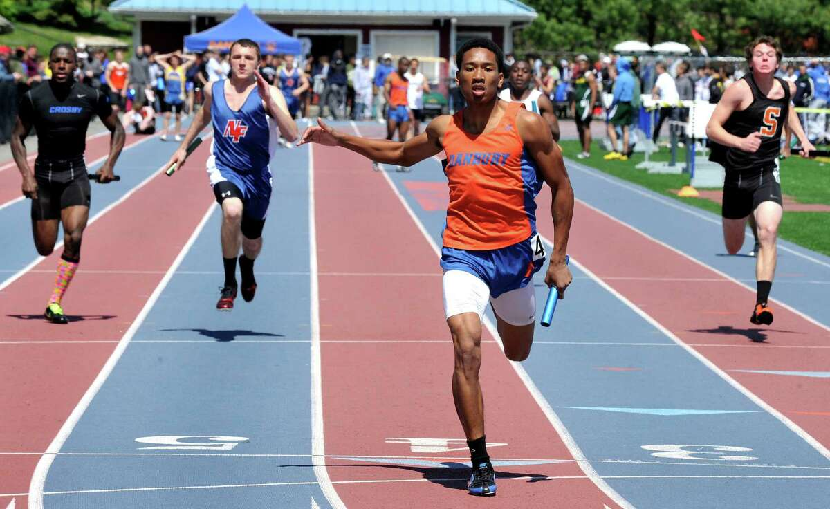 Rashid Stephenson crosses the finish line to win his heat for Danbury in the boys 4x100 meter relay during the O'Grady Relays at Danbury High School Saturday, April 28, 2012.