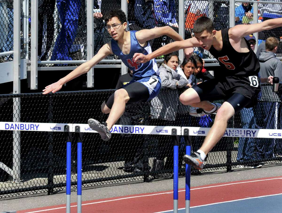 Matt Fairchild, center, competes for New Fairfield in the boys 300 meter hurdles, during the O'Grady Relays at Danbury High School Saturday, April 28, 2012.