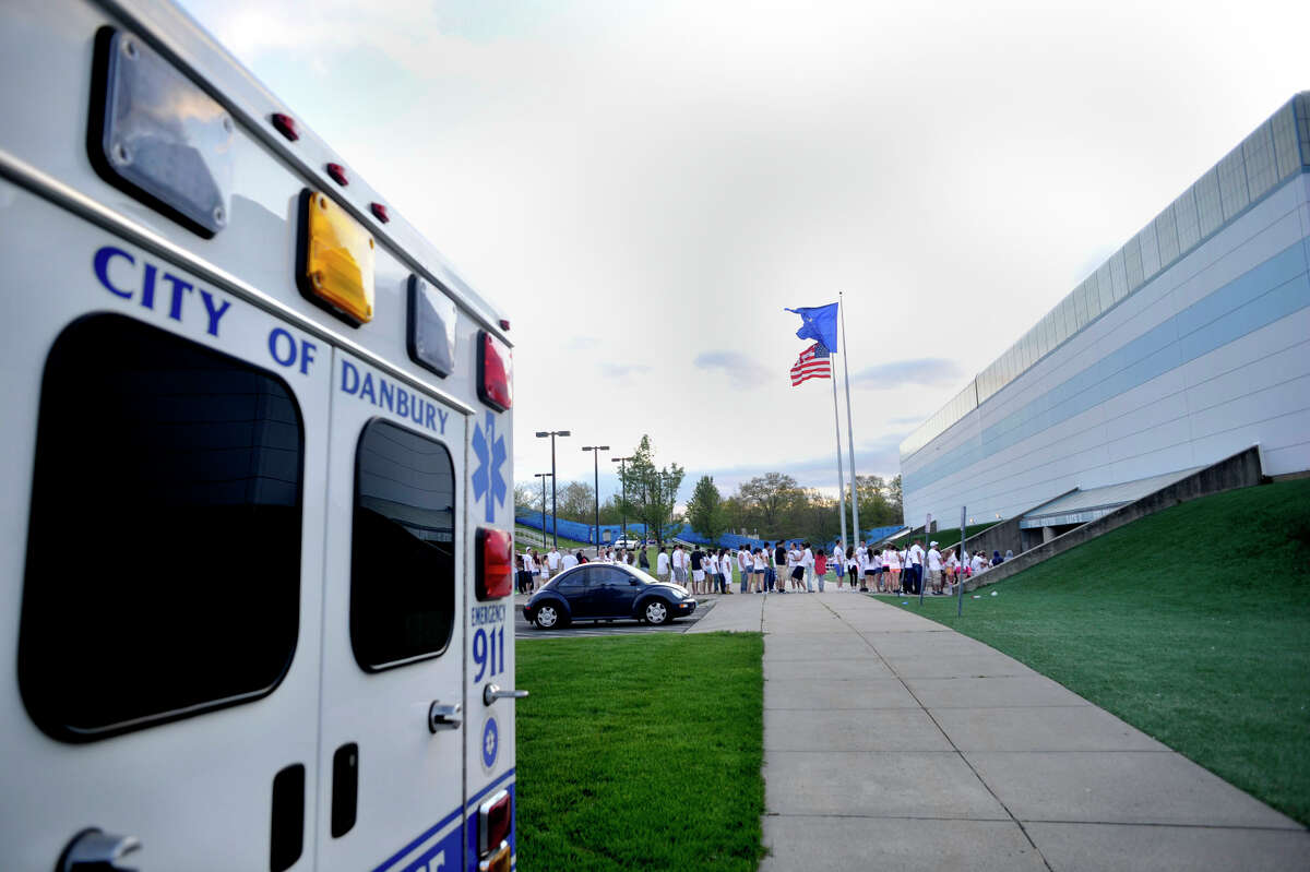 Emergency crews set up outside the O'Neil Center as fans wait in line for Dayglow at Western Connecticut State University's westside campus in Danbury, Conn., on Friday, April 27, 2012. Officials said 34 people were transported by ambulance to Danbury Hospital for mostly alcohol-related problems.
