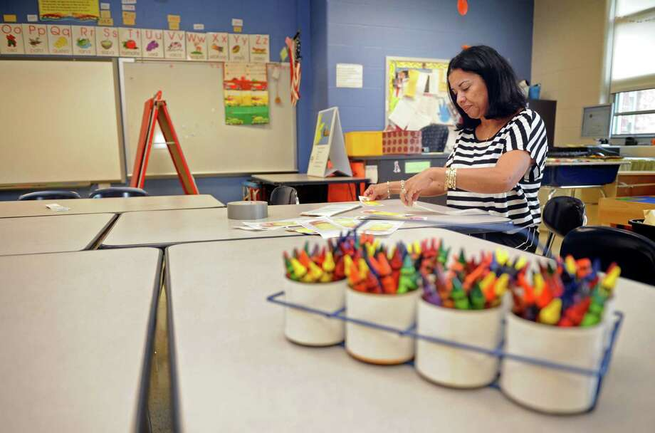 Kindergarten teacher Luz Malave makes name tags for her new students while setting up her classroom Friday, Aug. 19, 2011 at Barnum School in Bridgeport, Conn. Photo: Autumn Driscoll / Connecticut Post