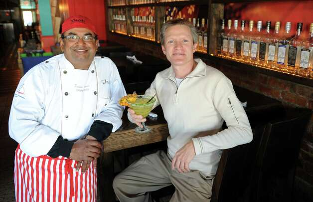 Chef Prasad Chirnomula and Tom Brandt sit in the dining room of their newly opened restaurant, Oaxaca Kitchen, in Westport, Conn. Photo: Autumn Driscoll / Connecticut Post