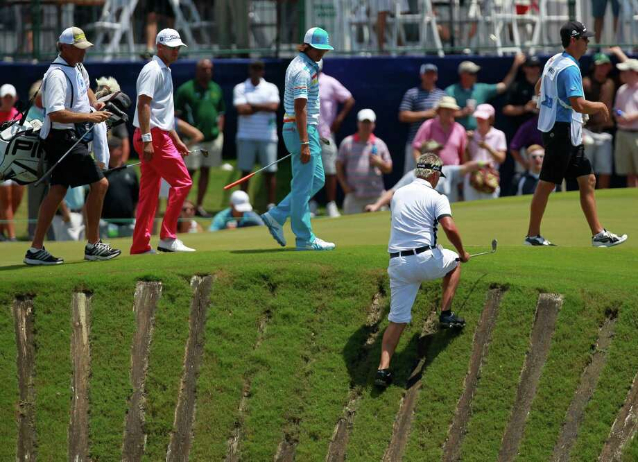 Daniel Chopra, of Sweden, climbs back onto the ninth green after hitting out of a lagoon during the third round of the Zurich Classic golf tournament at TPC Louisiana in Avondale, La., Saturday, April 28, 2012. (AP Photo/Gerald Herbert) Photo: Gerald Herbert, Associated Press / AP