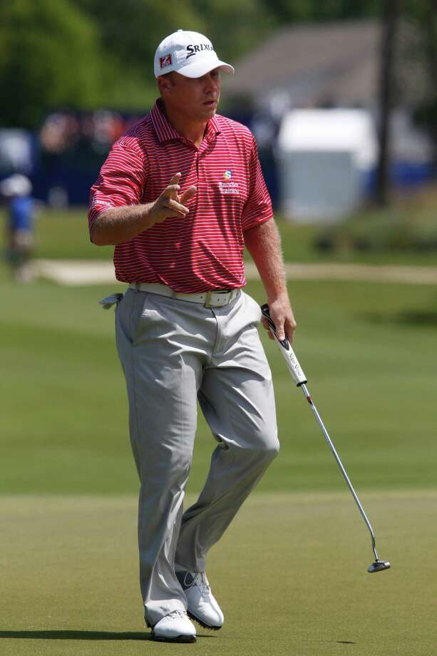John Rollins acknowledges the applause on the first green in the third round of the Zurich Classic at the TPC Louisiana course in Avondale, La., Saturday, April 28, 2012. (AP Photo/Bill Haber) Photo: Bill Haber, Associated Press / HABEB