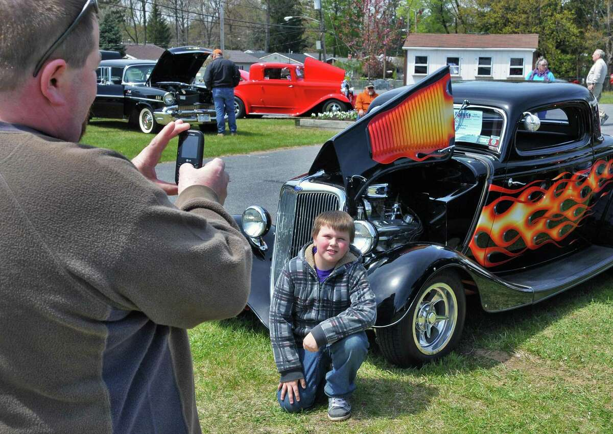 Don Brooks of Broadalbin takes a picture of his son Tyler,11, with a 1934 Ford hot rod at the Saratoga Nationals Expo car show at the Saratoga County Fairgrounds in Ballston Spa Saturday April 28, 2012. (John Carl D'Annibale / Times Union)
