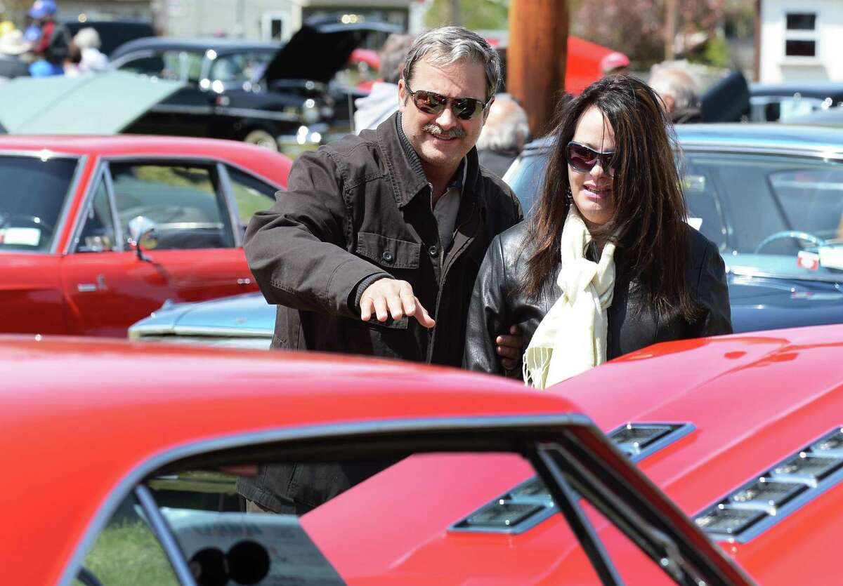 John Gocha and Ann Petraccione of Ballston Lake look over cars at the Saratoga Nationals Expo car show at the Saratoga County Fairgrounds in Ballston Spa Saturday April 28, 2012. (John Carl D'Annibale / Times Union)