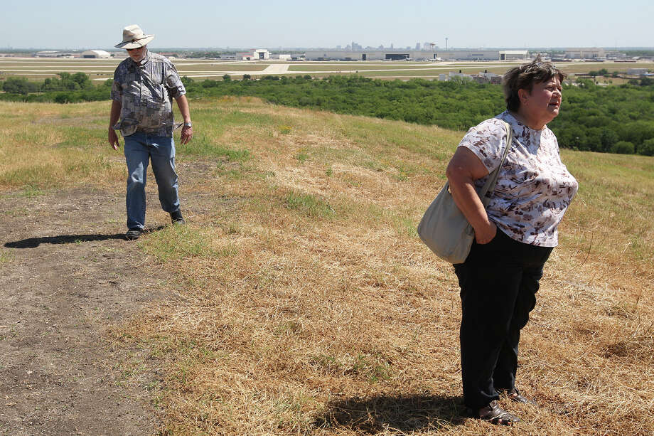 Southwest Community Association's John Adams and Carole Abitz and John Adams walk along the hills of a former landfill at Pearsall Park, Tuesday, April 24, 2012. If the upcoming San Antonio bond passes, the park is scheduled to received $7 million for its development. Photo: JERRY LARA, San Antonio Express-News / © 2012 San Antonio Express-News