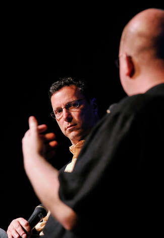 Andrew Karpen, left, president of Focus Features, is asked a question by Marty Lang, film professor at Quinnipiac University, during a discussion about Focus Features and the film industry in general during the Connecticut Film Festival at the Palace Theatre in Danbury, Conn., on Saturday, April 28, 2012. Photo: Jason Rearick / The News-Times