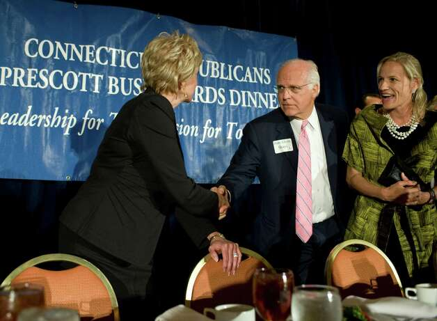 Republican U.S. Senate candidates Linda McMahon, left, and Chris Shays, right, shake hands at the Connecuticut GOP Prescott Bush Awards dinner in Stamford, Conn., Monday, April 23, 2012.Ann Romney told the packed crowd she believes her husband Mitt Romney has the right message to win the Democratic leaning state.  (AP Photo/Jessica Hill) Photo: Jessica Hill, Associated Press / AP2012