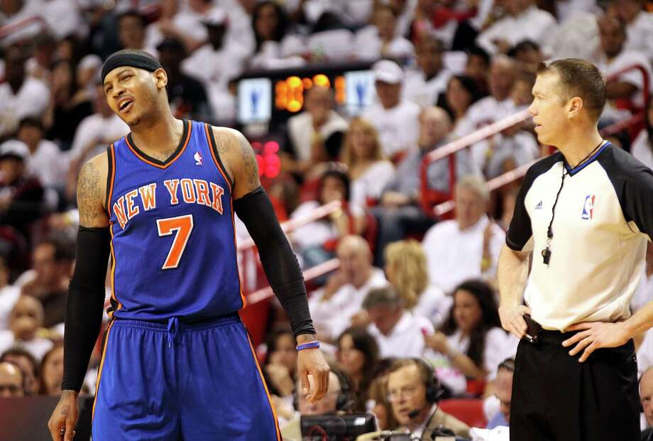 Carmelo Anthony of the Knicks reacts to a foul call during Saturday's 100-67 loss at Miami Saturday. Photo: Marc Serota, Marc Serota/Getty Images / 2012 Getty Images