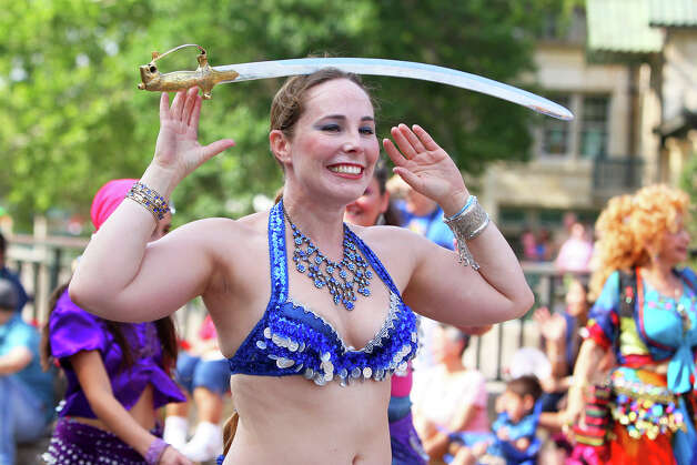 Stephanie Bigee balances a sword as she walks along King William Street with The Bedouin Dancers belly dance troupe during the Fiesta King William Fair Parade, Saturday, April 28, 2012. (JENNIFER WHITNEY) Photo: JENNIFER WHITNEY, Jennifer Whitney/ Special To The Express-News / special to the Express-News