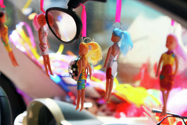 Dolls hang over the dash of the Cornyation 2012 Smartcar during the Fiesta King William Fair Parade, Saturday, April 28, 2012. (JENNIFER WHITNEY) Photo: JENNIFER WHITNEY, Jennifer Whitney/ Special To The Express-News / special to the Express-News