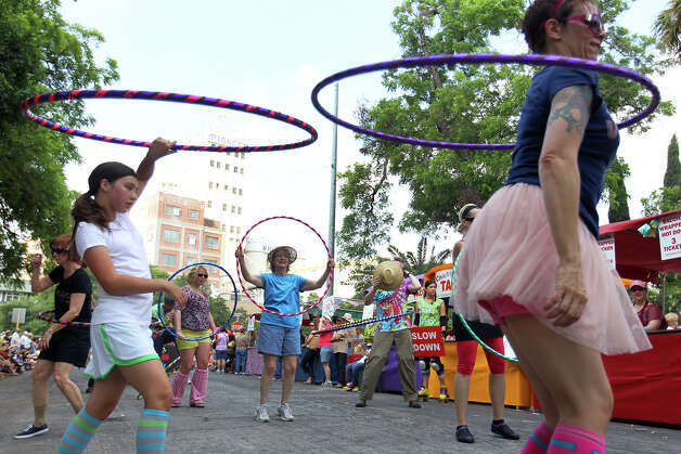 The Hot Hoopers work the parade route during the Fiesta King William Fair Parade, Saturday, April 28, 2012. (JENNIFER WHITNEY) Photo: JENNIFER WHITNEY, Jennifer Whitney/ Special To The Express-News / special to the Express-News