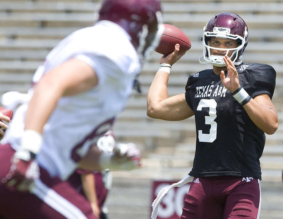 Texas A&M quarterback Jameill Showers goes through passing drills before the annual Maroon and White Game at Kyle Field Saturday, Apr. 28, 2012. (eagle photo/ stuart villanueva) Photo: Stuart Villanueva, BRYAN-COLLEGE STATION EAGLE