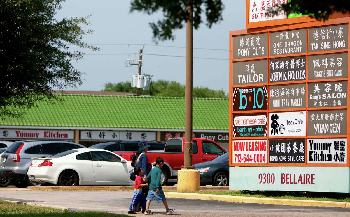 Customers stroll down Bellaire Boulevard next to Diho Square in the Chinatown Zone of the Sharpstown area. The international flavor of the area has some referring to it as the Ellis Island of Houston.