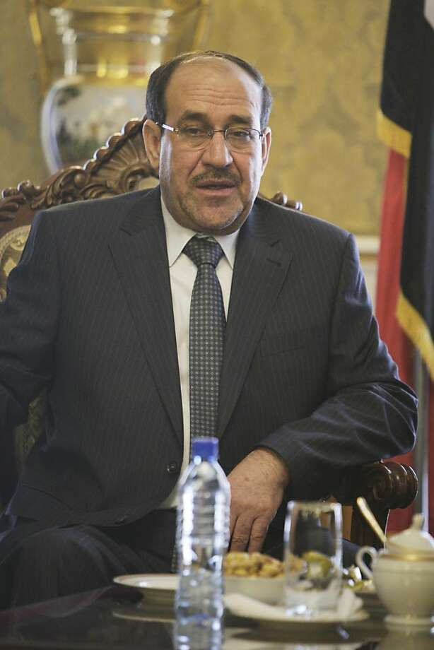 Iraqi Prime Minister Nouri al-Maliki talks with Iranian Vice-President Mohammad Reza Rahimi, unseen, after his official arrival ceremony in Tehran, Iran, Sunday, April 22, 2012. (AP Photo/Vahid Salemi) Photo: Vahid Salemi, Associated Press