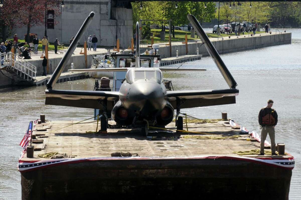 One of the three planes from the USS Intrepid museum makes it's way toward Lock 2 of the Erie Canal in Waterford N.Y. Saturday April 28, 2012. (Michael P. Farrell/Times Union)