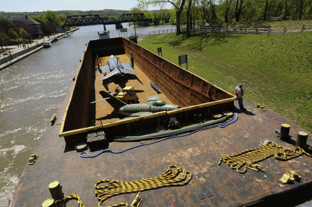 Two of the three planes from the USS Intrepid museum on a barge wait to enter Lock 2 of the Erie Canal in Waterford N.Y. Saturday April 28, 2012. (Michael P. Farrell/Times Union)