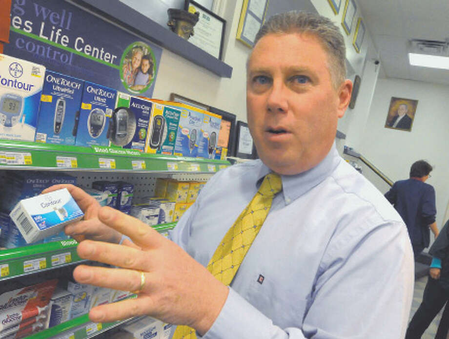 Cohoes Mayor and registered pharmacist John T. McDonald holds a box of  Contour glucose test strips at Marra's Pharmacy in Cohoes , New York Thursday Jan.26, 2012.( Michael P. Farrell/Times Union) Photo: Michael P. Farrell