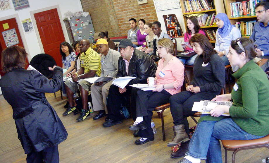 A multicultural group of 21 students who speak 24 different languages begin training as medical interpreters during an 80-hour weekend course in Albnay conducted by MAMI Interpreters, April 30, 2011. (Courtesy St. Peter?s Hospital)