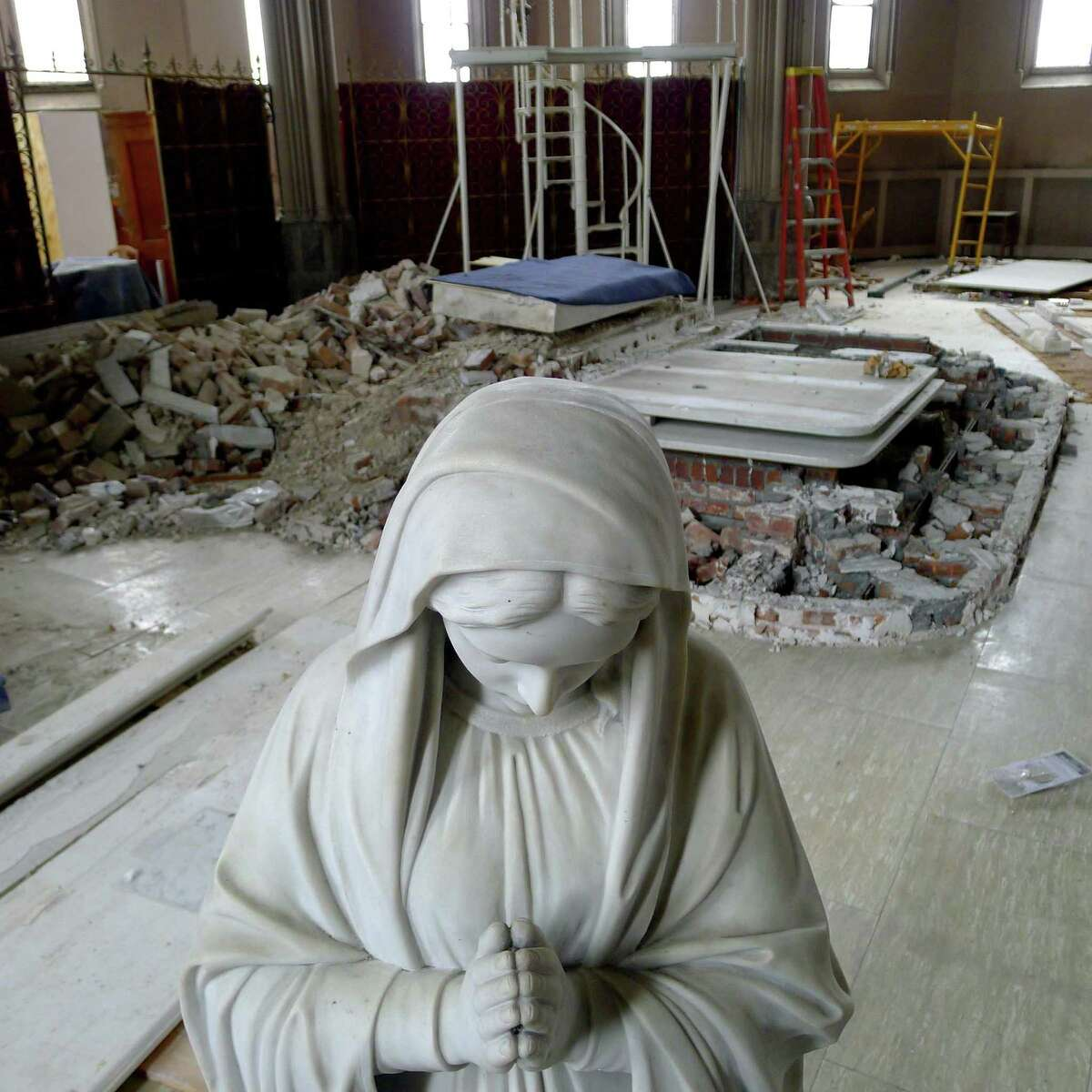 Religious icons being salvaged from St. Patrick's Church in Watervliet N.Y. Friday April 27, 2012. (Michael P. Farrell/Times Union)