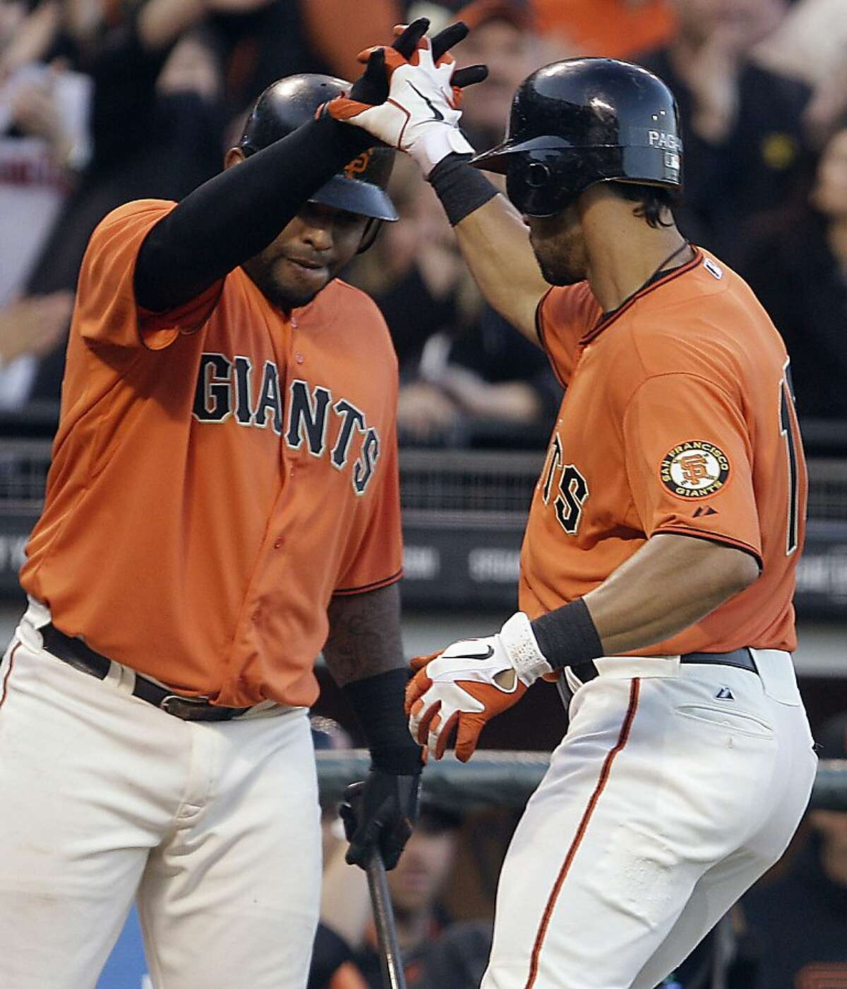 San Francisco Giants' Angel Pagan, right, is congratulated by teammate Pablo Sandoval after hitting a home run off San Diego Padres' Cory Luebke during the first inning of a baseball game on Friday, April 27, 2012, in San Francisco.