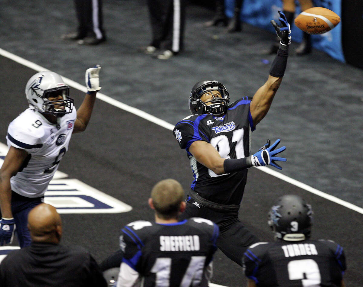 San Antonio Talons' Burl Toler misses a pass as he is defended by Chicago Rush's Brandon Freeman during second half action Saturday April 28, 2012 at the Alamodome. The Talons won 56-55.