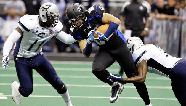 San Antonio Talons' Robert Quiroga looks for room between Chicago Rush's Kelvin Morris (left) and Chicago Rush's Brandon Freeman during first half action Saturday April 28, 2012 at the Alamodome. Quiroga will miss his eighth straight game for the Talons tonight. Photo: EDWARD A. ORNELAS, Express-News / © SAN ANTONIO EXPRESS-NEWS (NFS)