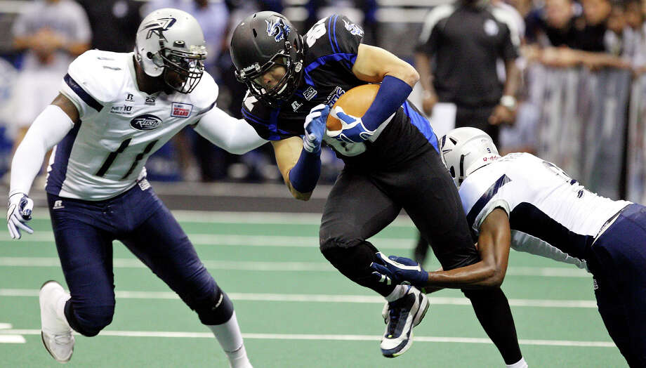 San Antonio Talons' Robert Quiroga looks for room between Chicago Rush's Kelvin Morris (left) and Chicago Rush's Brandon Freeman during first half action Saturday April 28, 2012 at the Alamodome. Photo: EDWARD A. ORNELAS, Express-News / © SAN ANTONIO EXPRESS-NEWS (NFS)