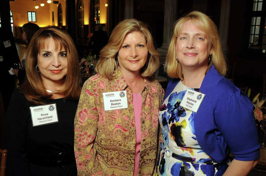 From left: Rose Harshfield, Barbara Beaton and Stephanie Haynes at the OTC Board Dinner hosted by the Greater Houston Convention and Visitors Bureau at the Julia Ideson Library Saturday, April 28, 2012. (Dave Rossman Photo) Photo: Dave Rossman, For The Chronicle / © 2012 Dave Rossman