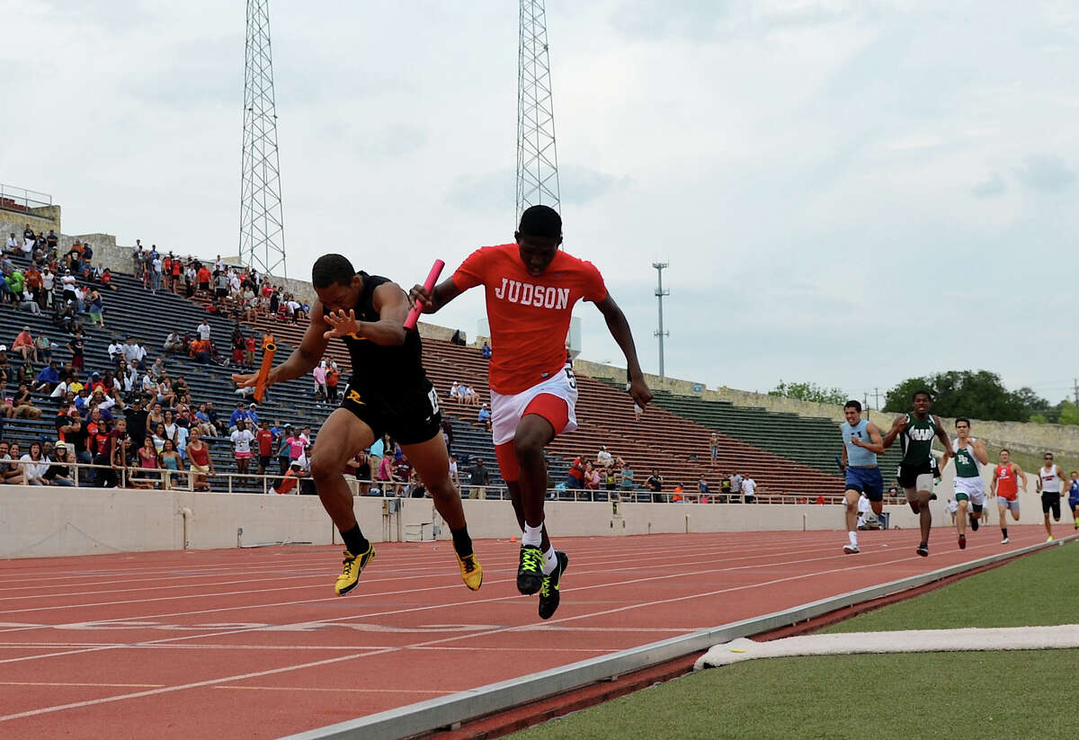 Judson's Jerome Gatewood (right) edges out East Central's Chris Armstrong (left) as they cross the finish line in the 5A boys 4x400 meter relay during the Region IV Track Meet on April 28, 2012 at Alamo Stadium in San Antonio Texas. John Albright / Special to the Express-News.