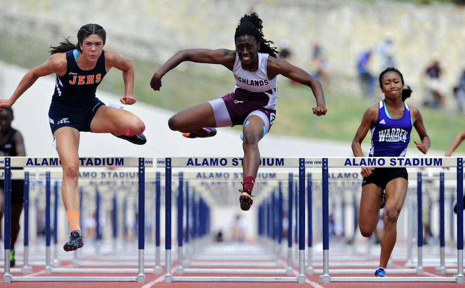 Highlands Jourdan Doffeny (center) clears the final hurdle on her way to winning the 5A girls 100 meter hurdles during the Region IV Track Meet on April 28, 2012 at Alamo Stadium in San Antonio Texas.  Doffeny edged out Edinburg Economedes' Leigha Brown (left).