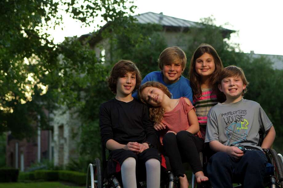From left, Peter, 10, Willa, 6, Noah, 10,  Misha, 9, and Aaron Berry, 9, outside their home Thursday, April 19, 2012, in Bellaire.  Joshua and Robin Berry were killed in an automobile accident in west Texas on July 2, 2011 on their way back from a family vacation in Colorado. Photo: Johnny Hanson, Houston Chronicle / © 2012  Houston Chronicle