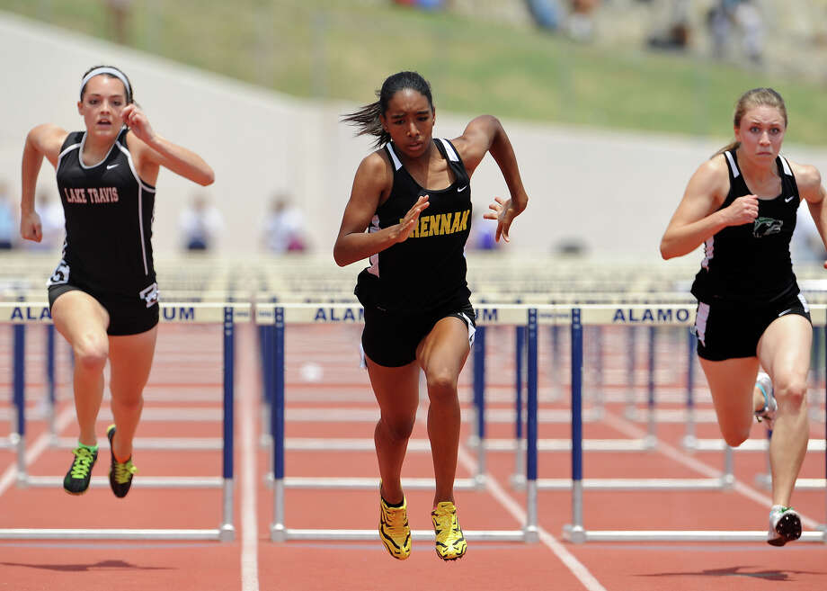 Brennan's Autym Scales (center) races to the finish line on her way to winning the 4A girls 100 meter hurdles during the Region IV Track Meet on April 28, 2012 at Alamo Stadium in San Antonio Texas. John Albright / Special to the Express-News. Photo: JOHN ALBRIGHT, San Antonio Express-News / San Antonio Express-News