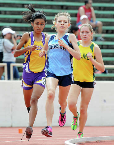 Johnson's Natalie Langan leads San Benito's Brenda Lopez and Holmes' Stephanie Barlow in the 5A girls 1600 meter run during the Region IV Track Meet on April 28, 2012 at Alamo Stadium in San Antonio Texas. John Albright / Special to the Express-News. Photo: JOHN ALBRIGHT, San Antonio Express-News / San Antonio Express-News