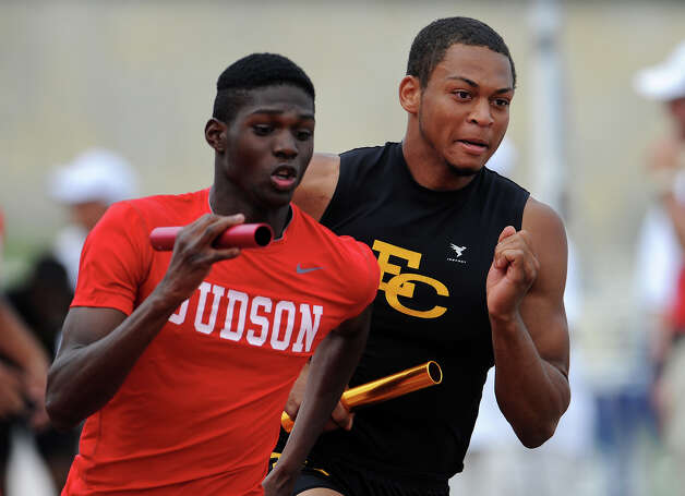 Judson's Jerome Gatewood and East Central's Nick Coleman run side by side in the final leg of the 5A boys 4x400 meter relay during the Region IV Track Meet on April 28, 2012 at Alamo Stadium in San Antonio Texas. John Albright / Special to the Express-News. Photo: JOHN ALBRIGHT, San Antonio Express-News / San Antonio Express-News