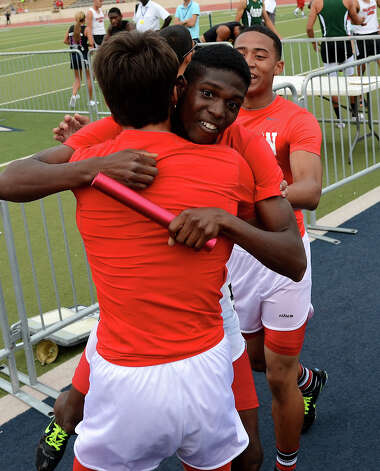 Judson's Jerome Gatewood is congratulated by his teammates after finishing first in the 5A boys 4x400 meter relay during the Region IV Track Meet on April 28, 2012 at Alamo Stadium in San Antonio Texas. John Albright / Special to the Express-News. Photo: JOHN ALBRIGHT, San Antonio Express-News / San Antonio Express-News