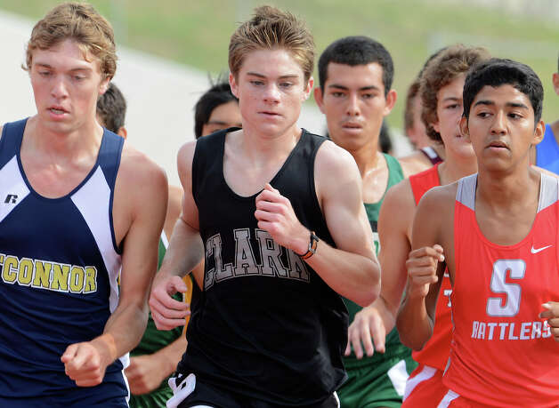 Clark's Austin Wells squeezes through traffic during the 5A boys 3200 meter run during the Region IV Track Meet on April 27, 2012 at Alamo Stadium in San Antonio Texas. John Albright / Special to the Express-News. Photo: JOHN ALBRIGHT, San Antonio Express-News / San Antonio Express-News