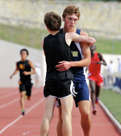 Clark's Austin Wells and O'Connor's Ryan McCann congratulate each other after both qualified for the State meet after finishing first and second in the 5A boys 3200 meter run during the Region IV Track Meet on April 27, 2012 at Alamo Stadium in San Antonio Texas. John Albright / Special to the Express-News. Photo: JOHN ALBRIGHT, San Antonio Express-News / San Antonio Express-News