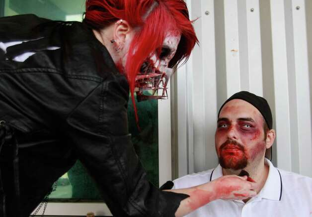 Robert Manyon gets his makeup done by Kiera Chung, a makeup artist, before the Zombies on a Ferry event. Photo: SOFIA JARAMILLO / SEATTLEPI.COM
