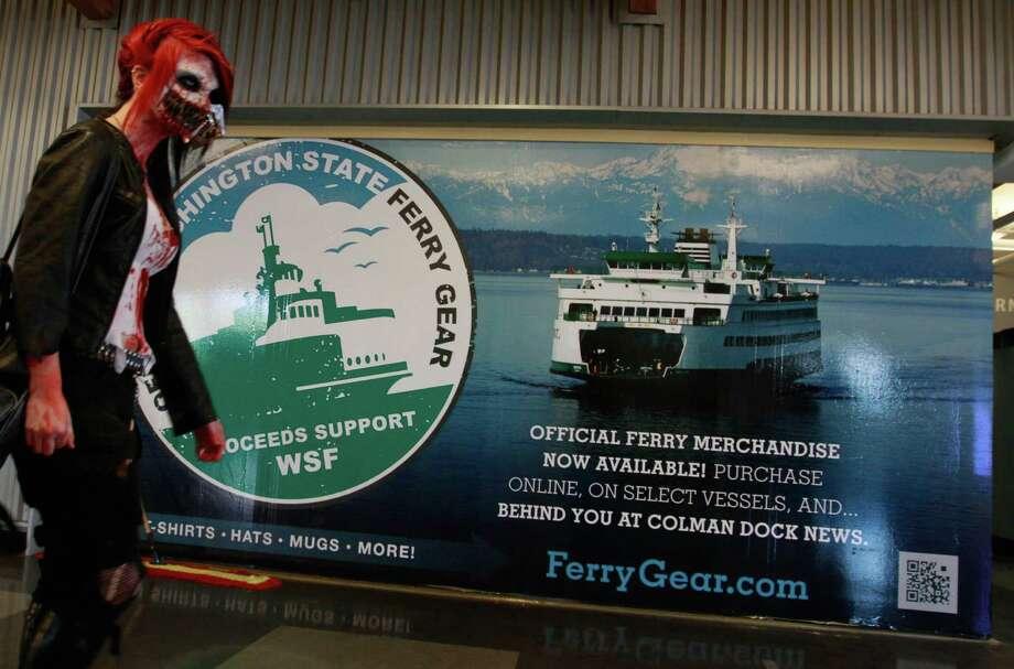 Kiera Chung creeps around the Seattle ferry terminal. Photo: SOFIA JARAMILLO / SEATTLEPI.COM