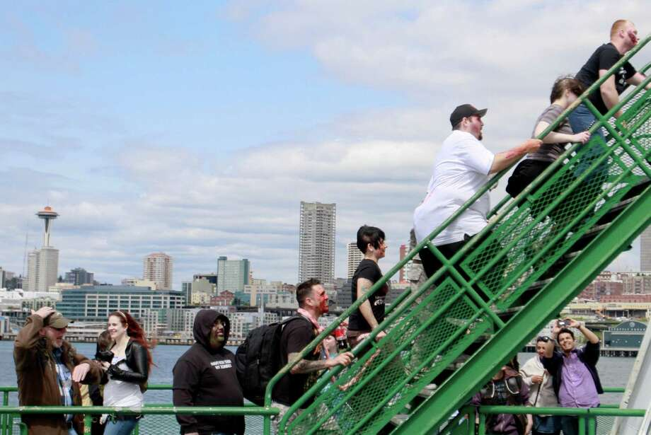 Dozens of zombies invaded the Bremerton ferry on their way to a live concert benefiting the Protect the Children Foundation. Photo: SOFIA JARAMILLO / SEATTLEPI.COM