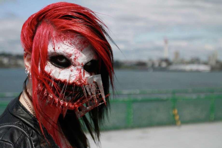 Kiera Chung, a makeup artist, shows off her zombie costume. Photo: SOFIA JARAMILLO / SEATTLEPI.COM