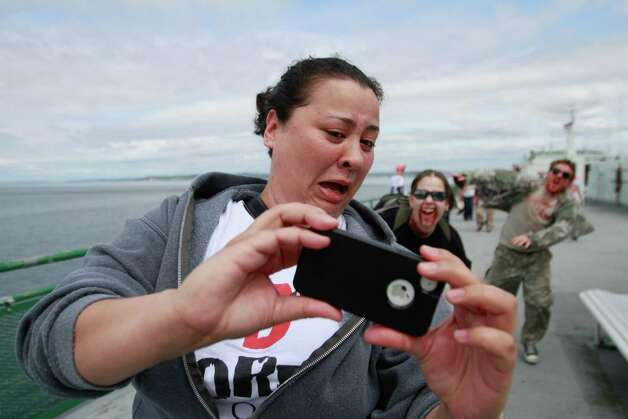 A victim takes photos while being chased by zombies. Photo: SOFIA JARAMILLO / SEATTLEPI.COM