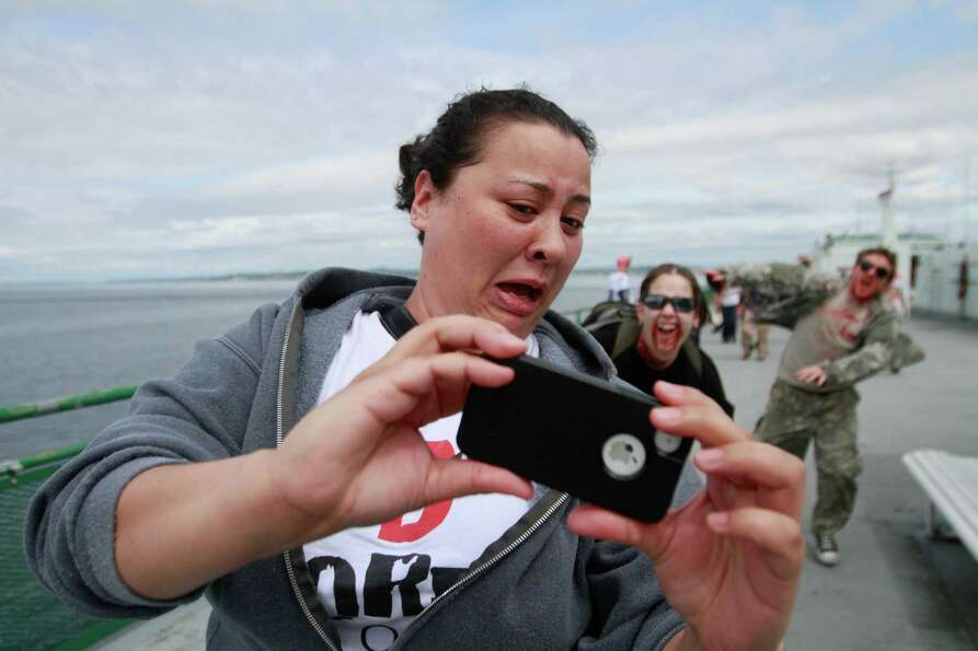 A victim takes photos while being chased by zombies.