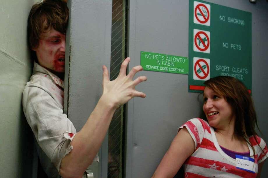 A zombies and his victim pose for a photo. Photo: SOFIA JARAMILLO / SEATTLEPI.COM